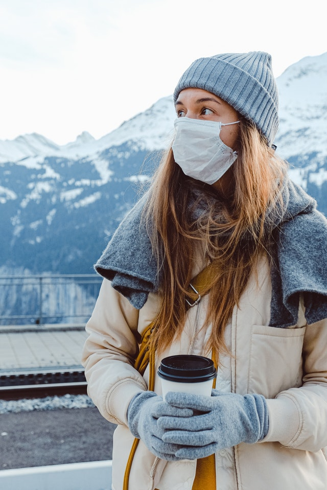 Woman wearing face mask look at mountains